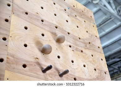 Wooden climbing fingerboard for training.  Close up