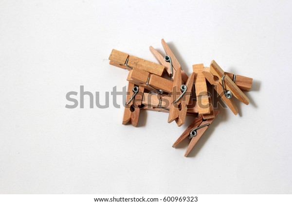 Wooden clip on white background