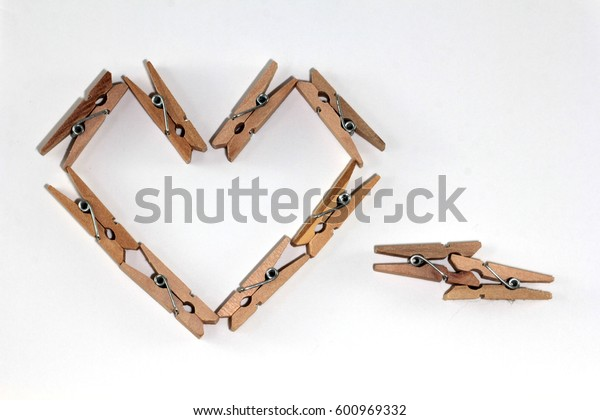 Wooden clip on white background with heart shaped