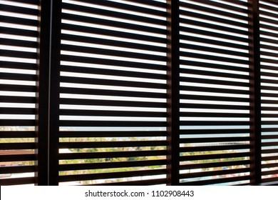 Wooden closed Shutters on the Windows of the House. Horizontal Blinds design