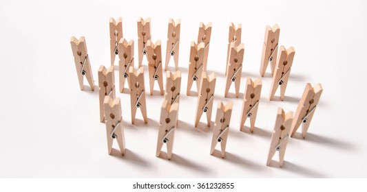 wooden cloth pegs, isolated on white background