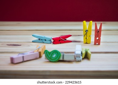 Wooden clothes peg on wooden table