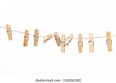 Wooden clothes pegs isolated on a white background.