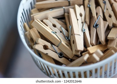 Wooden clothespins in the basket, blur, bright photo. The concept of eco-consumption, the use of natural materials, awareness.