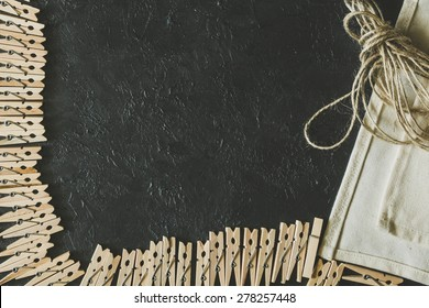 Wooden clothespins on a black background