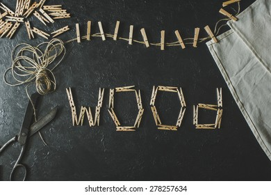 Wooden clothespins on a black background( Wood )