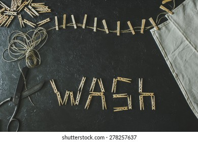 Wooden clothespins on a black background ( Wash )