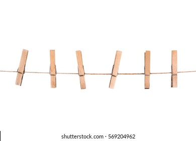 wooden clothespins on a rope. Isolated on a white background