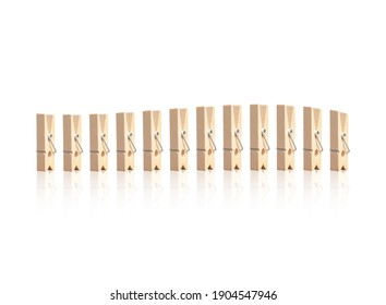the Wooden clothespins in white background
