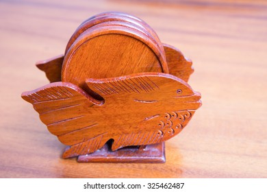 wooden coasters for glass on wood background