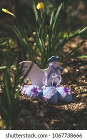 Wooden cockerel in spring garden