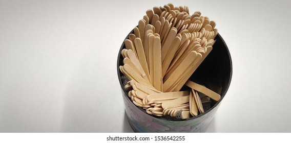 Wooden coffee stirrer inside a cup