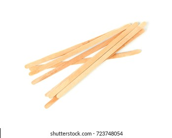 Wooden coffee stirrers on white background