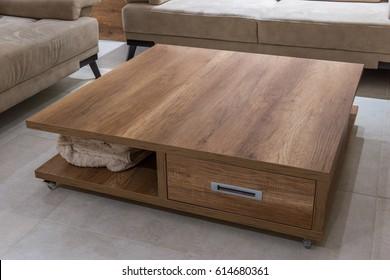 Wooden coffee table in home interior, coleup