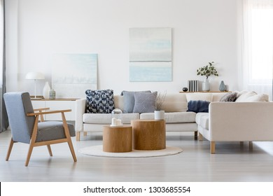 Wooden coffee tables in the middle of fashionable living room interior with corner sofa