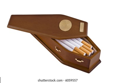 Wooden coffin containing cigarettes.  This is a conceptual image for the perils of smoking or quitting smoking.  The casket has brass handles and two brass plates, perfect for adding text.