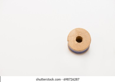 Wooden coil on white background, thread, isolate