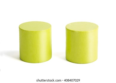 Wooden color green cylinders on a white background