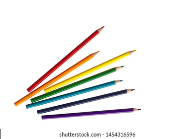 wooden color pencils arranged in bulk on a white isolated background