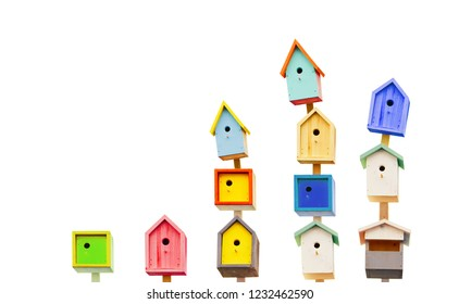 Wooden colorful birdhouses isolated on a white background. Life in the neighborhood. Nesting season.