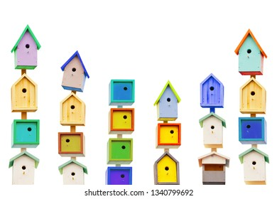 Wooden colorful birdhouses isolated on a white background