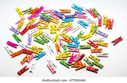 Wooden colorful clothespins on a white background. Isolate