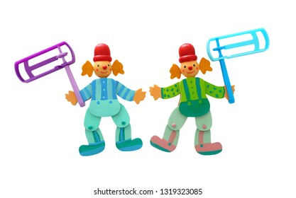 wooden colorful clowns and plastic noisemaker or gragger for purim celebration holiday (jewish holiday) isolated on white