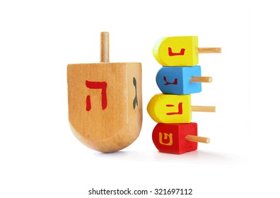 wooden colorful dreidels (spinning top) for hanukkah jewish holiday isolated on white