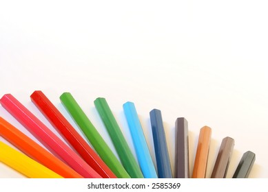 Wooden colour pencils close-up composition. Isolated over white.
