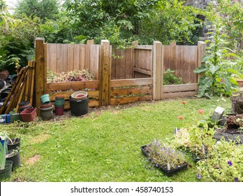 wooden compost bins in garden setting