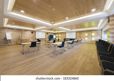 wooden conference room with presentation wall and projector