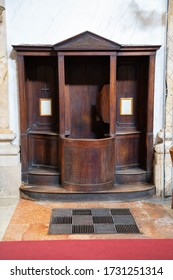 Wooden confessional in a italian church, Italy