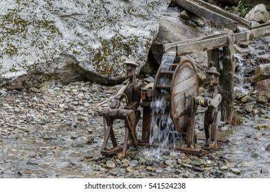 wooden construction of a waterwheel with stream
