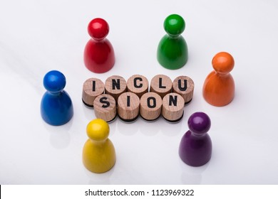 Wooden Cork With Inclusion Text In Front Of Multi Colored Pawn On Reflective Background