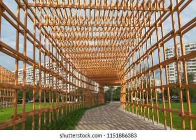 A wooden corridor for walks in the park. Inside view. City Park.