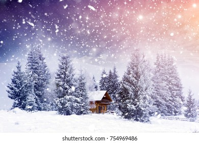 Wooden cottage in a fairy-tale winter landscape.