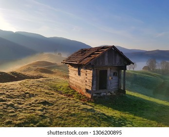 wooden cottage in a foggy morning