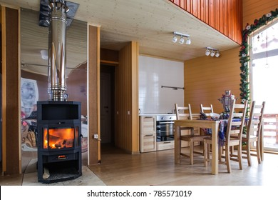 wooden cottage interior with new year and Christmas decoration, fire place, big panoramic windows and wooden terrace