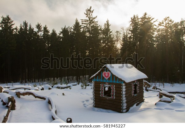 Wooden cottage for kids in forest.