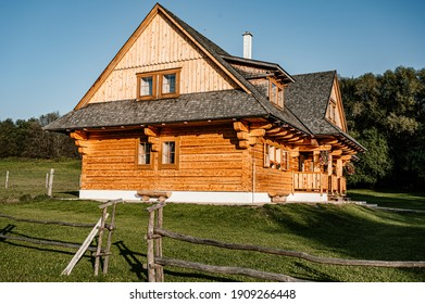 Wooden cottage in nature in sunny day. Recreation center in the mountains. Modern eko hausing in nature.