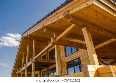 Wooden cottage on blue sky background