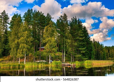 Wooden cottage in summer on the lake in Finland