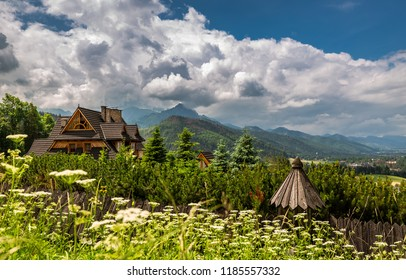 Wooden cottage and Tatra mountain in summer, Poland