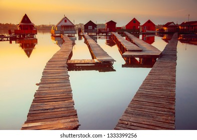Wooden cottages on the Bokod lake in Hungary