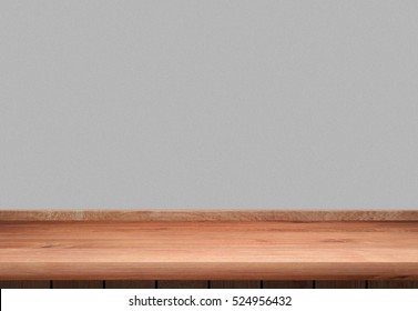 Wooden counter or table and gray wall background.