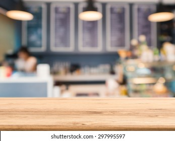 wooden counter top with bakery shop blurred background