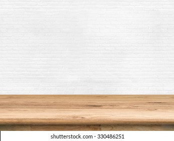 wooden counter top with brick wall background