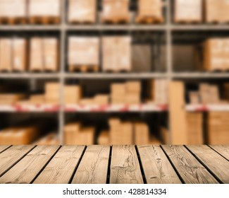 wooden counter with warehouse blurred background