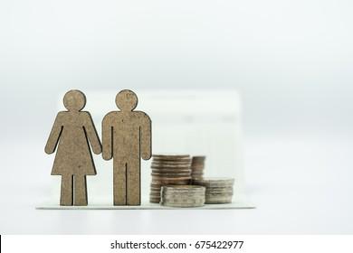 Wooden couple icon and coins stack on bankbook on white background. Concept of money saving, financial, personal loan,retirement,insurance.