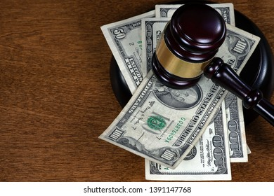 wooden courtroom gavel on American currency